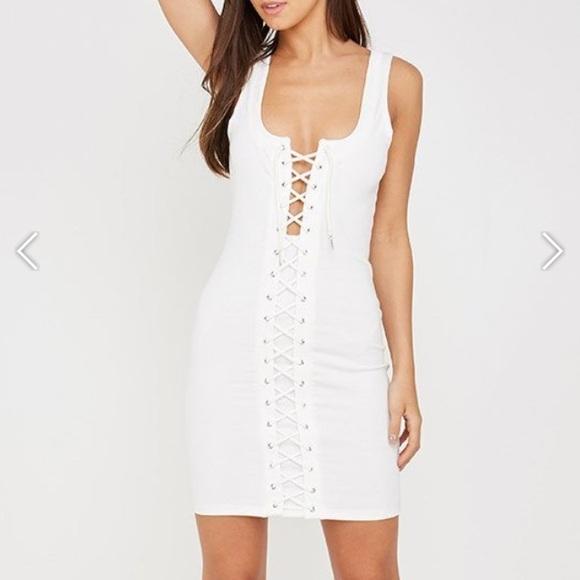 f94f68348ddd White lace up mini dress. NWT. maniere de voir. M_5a4942b32ae12f792b018d74.  M_5a4942b472ea8807a4018da3. M_5a4941cfcaab443d7f018c97